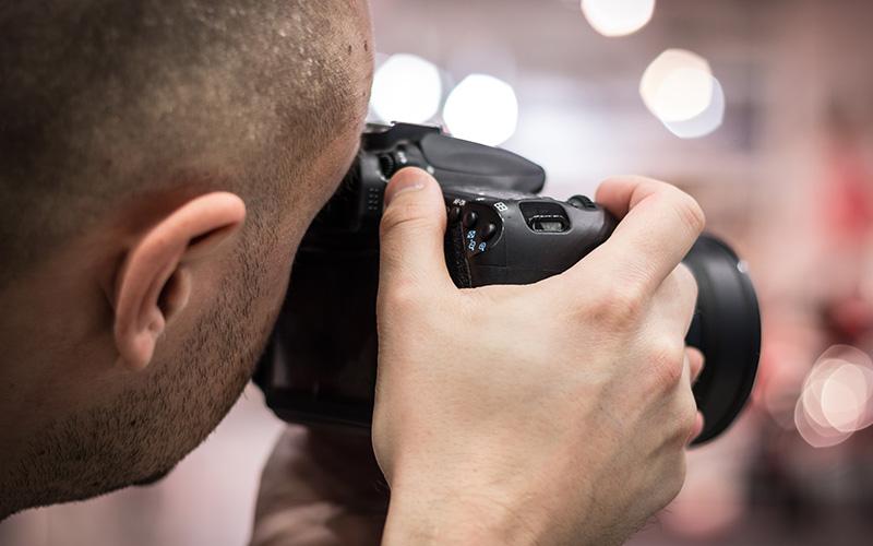 Man taking photos of house